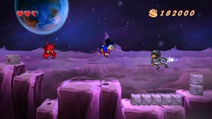 DuckTales: Remastered - Scrooge McDuck using his cane as a pogo stick in the Moon stage of the game.