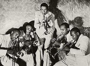 "Mills Blue Rhythm Band - Mills Blue Rhythm Band. From left to right: George Washington, J. C. Higginbotham, Henry ""Red"" Allen, Wardell Jones and Shelton Hemphill"