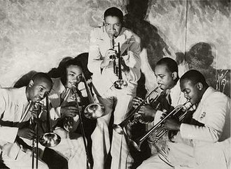 "Mills Blue Rhythm Band - Mills Blue Rhythm Band. From left to right: George Washington, J. C. Higginbotham, Henry ""Red"" Allen, Wardell Jones and Shelton Hemphill"