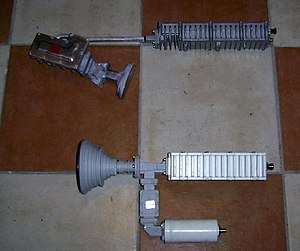 Block upconverter - BUC: Block upconverter, Ku band Top: Hughes 1W   Bottom: Feed horn with short section of waveguide, Andrew 2W BUC and Swedish microwave LNB
