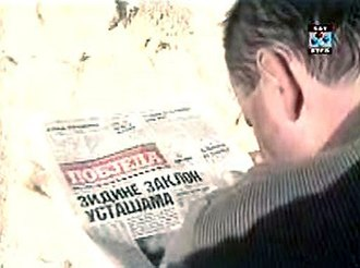 """Propaganda during the Yugoslav Wars - A JNA soldier reads the propaganda of """"Pobjeda"""", in which the newspaper describes Ustaše hiding behind the walls of Dubrovnik."""