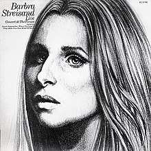A black and white image of the singer's face appears, with her head positioned towards the left side of the cover.