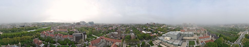 The campus of the University of Chicago, from the top of Rockefeller Chapel, the Main Quadrangles can be seen on the left (West), the Oriental Institute and the Becker Friedman Institute for Research in Economics can be seen in the center (North) and the Booth School of Business and Laboratory Schools can be seen on the right (East), as the panoramic is bounded on both sides by the Midway Plaisance (South).