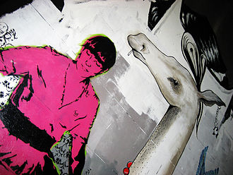 Street art in Melbourne - She's Only Dancing by Vexta (left), and work by PETS (right), in Hosier Lane, 2007