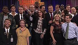 "The cast and special guests of the 30 Rock episode ""Live Show"" stand on the set of The Girlie Show with Tracy Jordan. From left to right: Tracy Morgan, Jack McBrayer, unidentified, Matt Damon, Rachel Dratch, Scott Adsit, Grizz Chapman, Tina Fey, Cheyenne Jackson, Alec Baldwin, Jane Krakowski, Jon Hamm, Kevin Brown, Julia Louis-Dreyfus, Chris Parnell, Bill Hader, and John Lutz"