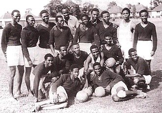 "Nigeria national football team - The Nigeria ""UK Tourists"" national team prior to their tour of the UK in 1949. The team were known among the West African nations at the time as the ""Red Devils"" due to their red shirts."