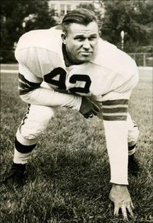 Palmer in a three-point stance in a Browns uniform, circa 1950