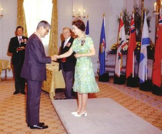 Order of Canada - Elizabeth II, Queen of Canada and Sovereign of the Order of Canada, invests Jules Léger as a Companion of the order at Rideau Hall, August 1973
