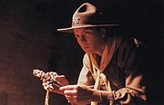 Indiana Jones (River Phoenix), aged 13, holding the Cross of Coronado