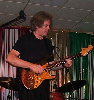 John Jorgenson - John Jorgenson performs in Liverpool (2006) with his Fender Hellecaster guitar.