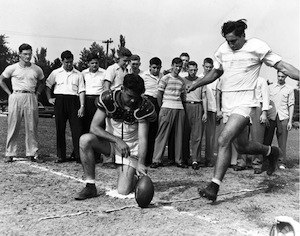 Lou Groza demonstrates kicking technique, 1947