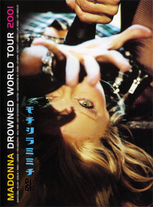 Madonna laying upside down with her hand stretched towards the camera