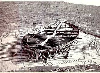 Nemi ships - The remains of the hull of one of the two ships recovered from Lake Nemi. Workers in the foreground give an indication of scale.