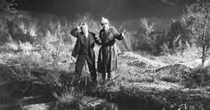 The Hound of the Baskervilles (1929 film) - Screenshot of Watson (left) and Holmes (right) on the moors