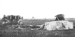 A photograph of a wrecked Tiger 007 tank in a field