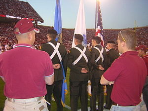 University of Oklahoma Army ROTC - An OU Army ROTC color guard stands at parade rest moments before advancing onto the football field at an OU Sooners football game.