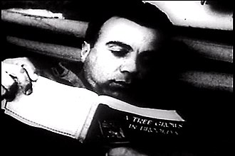 """Armed Services Editions - US Serviceman Nunzio Antonio """"Jim"""" Giambalvo reads an Armed Services Edition of A Tree Grows in Brooklyn"""