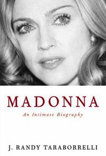 "Image of a blond, middle-aged woman in greyscale, on a white background. She has bright eyes, and looks upwards towards the left of the image. Beneath her image, the title ""Madonna"" is written in red capital letters, followed by ""An Intimate Biography"" below it. Further down, the words ""J. Randy Taraborrelli"" is written in black."