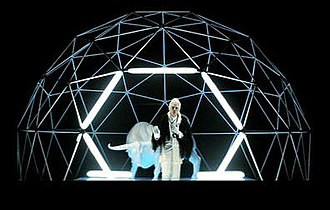 "Without You (Empire of the Sun song) - Luke Steele posing in the neon dome in the music video for ""Without You""."