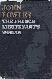 A red, first-edition hardback cover of The French Lieutenant's Woman with gold embossed title and author's name on the front cover and a black printed bramble of thorns separating the two.