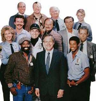 Hill Street Blues - Hill Street Blues cast, circa 1986, left to right, from bottom: Taurean Blacque, Daniel J. Travanti, Michael J. Warren; Second Row: Betty Thomas, James B. Sikking; Third Row: Robert Clohessy, Dennis Franz, Kiel Martin, Joe Spano; Top Row: George Wyner, Peter Jurasik, Robert Prosky, Megan Gallagher