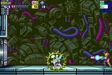 A video game screenshot of a person in a powered exoskeleton firing a missile at a monster.