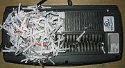 The 'cutting head' of a small shredder.