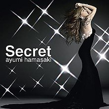 "On the right side, Ayumi Hamasaki is shown fully on her right side wearing a long bareback black dress with her arms up and a tattoo shown going from her upper right back to her right shoulder. On the left side is written ""Secret"", and under that in a smaller size lowercase ""ayumi hamasaki"". The background is dark grey, with flashing lights."