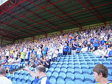 Stockport county fans in the Cheadle End stand during a match.