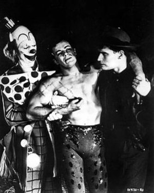 The Greatest Show on Earth (film) - James Stewart and Charlton Heston help an injured Cornel Wilde leave the center ring with dignity.