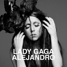 Greyscale image of Gaga with unkempt black hair which falls around her face. A crow sits on top of her head.