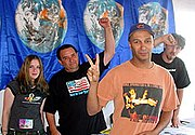Guitarist Tom Morello with Not in Our Name volunteers at an Axis of Justice tent at the July 13, 2003 Lollapalooza festival in Columbus, Ohio.