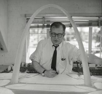 Gateway Arch - Saarinen working with a model of the arch in 1957