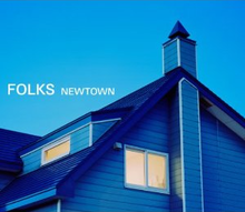 "The top of a wooden blue house in twilight, against a blue sky. The words ""FOLKS NEWTOWN"" are written in white against the sky."
