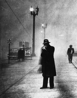 1939 St. Louis smog - A man lights a cigarette as streetlights along Olive glow during the daytime hours of November 28, 1939. St. Louis Post-Dispatch