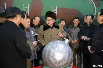 North Korea and weapons of mass destruction - Kim Jong-un, with what North Korea claims is a miniaturized silver spherical nuclear bomb, at a missile factory in early 2016.