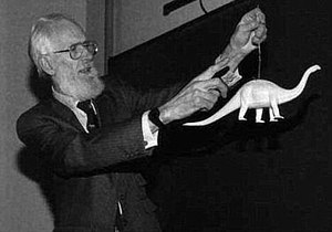 Robert McNeill Alexander - Demonstrating a biomechanics point with a dinosaur model