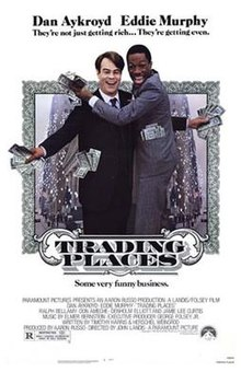 Theatrical release poster showing Dan Aykroyd and Eddie Murphy as their respective characters, with dollar bills in their hands and pockets.