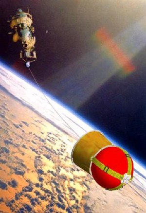Space tether missions - Artist's conception of the deployment of the YES2 tether experiment and Fotino capsule from the Foton spacecraft