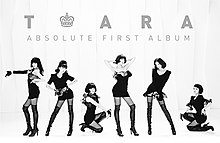 "A black and white landscape photo; the six members are styled in a retro fashion wearing leather high heel boots and short, tight-fitting dresses. The group poses strategically as ""T-ara"" appears above, with a crown graphic acting as a hyphen, and ""Absolute First Album"" below; both in all caps and a san-serif typeface."