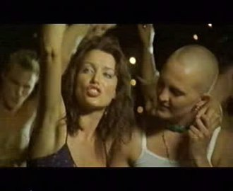 "Everlasting Night - Minogue and a party-goer in the music video for ""Everlasting Night""."