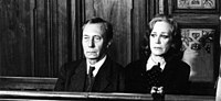 Man and woman on trial (black & white photo)
