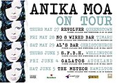 A white poster reading 'Anika Moa on tour', with venues and sponsors below. Four copies of the cover art of Love in Motion are on the left edge of the poster