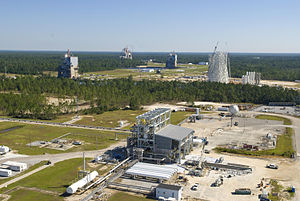 John C. Stennis Space Center - An aerial photo shows all three NASA Stennis Space Center (SSC) test complexes - the E Test Complex (foreground), the three A Test Complex stands (middle) and the B Test Complex (back).