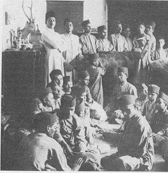 Salim Ali - Ali (standing at left) with students of the Victoria Jubilee School for the Blind at the Prince of Wales Museum in 1927