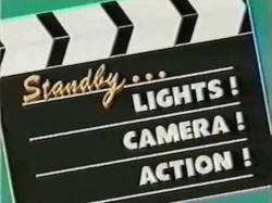 Standby...Lights! Camera! Action! title card.png