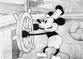 A cartoon mouse is operating a ship's steering wheel
