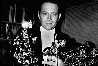 "Stephen R. Johnson - Stephen R. Johnson holding his MTV ""Moonman"" awards."