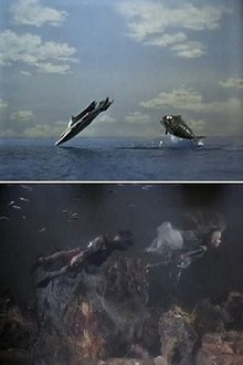 In the top image, a sleek combat submarine has propelled itself out of the ocean and is about to dive back under the water. Right behind it is a submersible resembling a giant fish, which has just cleared the water and is now in mid-air. In the bottom image, a man and a woman swim along the ocean floor. Fish can be seen in the top-left corner. While the man is wearing a wetsuit and breathing equipment, the woman is dressed only in a multi-layered cloak, which appears to be moving with the current.