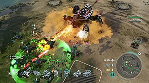 Halo Wars 2 - UNSC forces attacking a Banished Scarab. The green circle surrounding UNSC units is an active leader ability that restores health to the enclosed units.